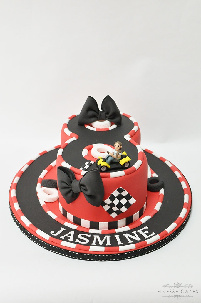 red and black go karting birthday cake for an 8 year old girl finesse cakes essex