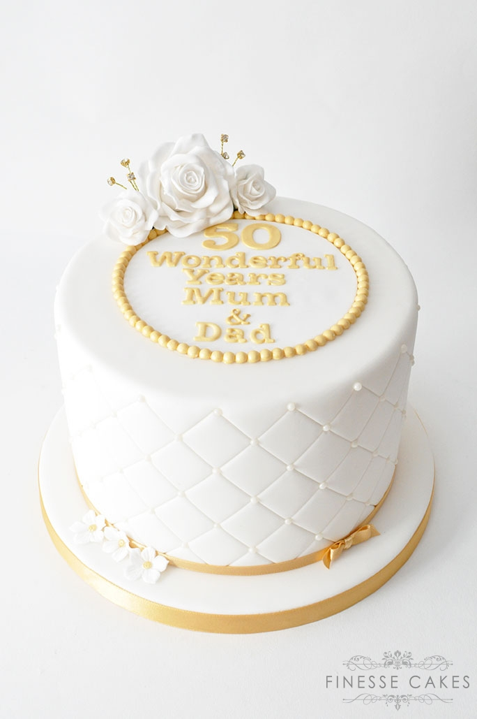 Golden wedding anniversary cake with icing flowers and 50 Essex cake makers